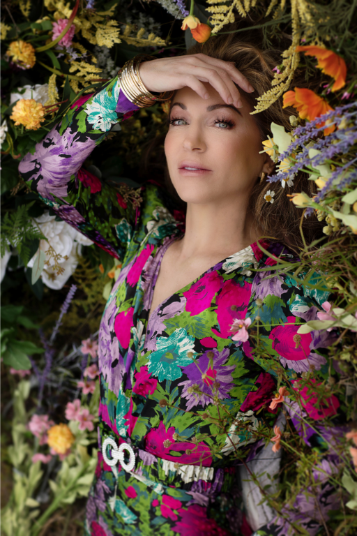 Jennifer Sassi Pavich x LUXYMOM® - woman laying in bed of flowers