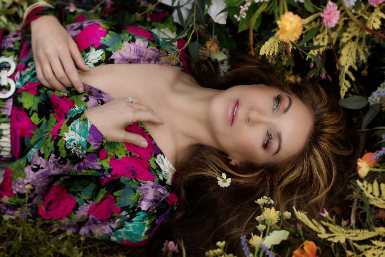 beautiful woman laying in flowers - ethereal beauty